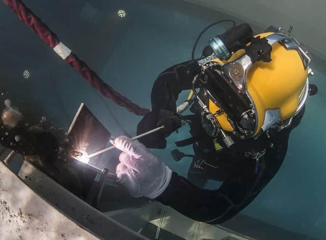 image of underwater welder welding