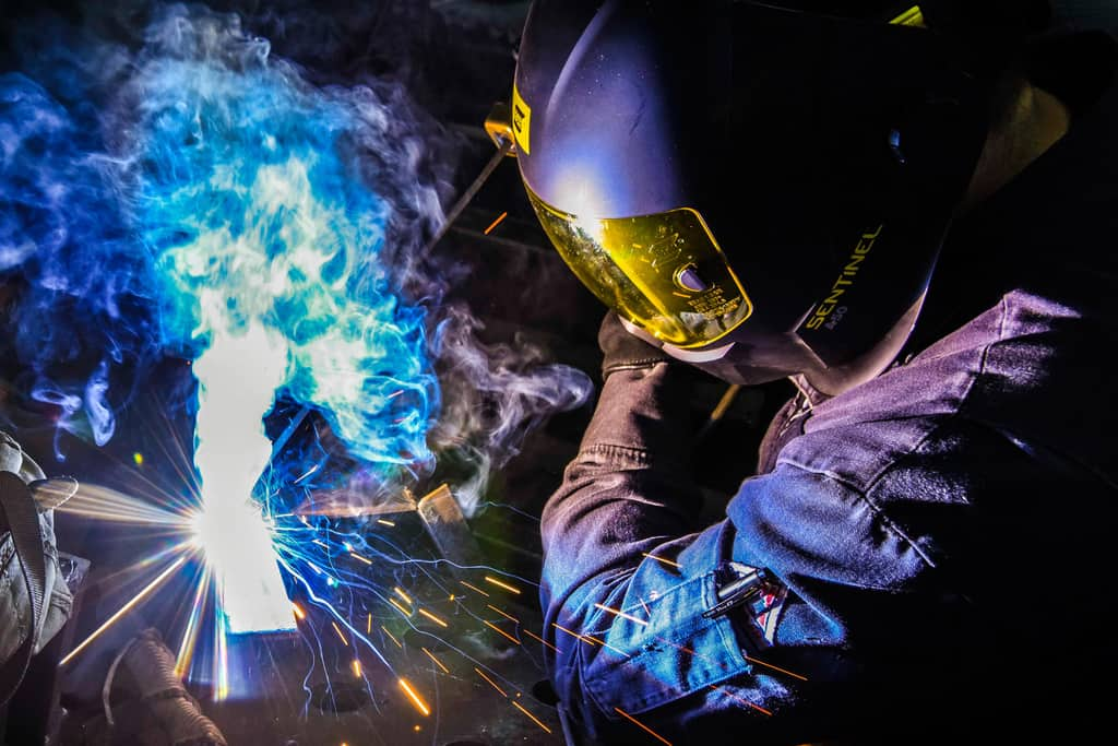 Hull Technician 3rd Class Jose Rodriguez welds L-brackets together aboard the aircraft carrier USS Ronald Reagan.