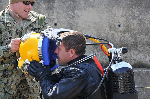 image of diver getting ready for underwater job