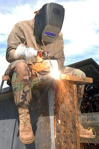 Image of a Military support welder working on a construction