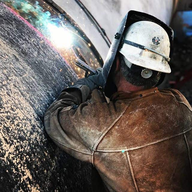 Image of a worker welding a pipe in Nevada