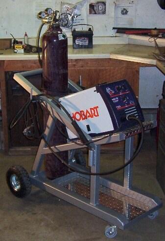 Welding machine and a welding gas cylinder on a welding cart