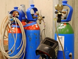 Different colors on gas cylinders are there for different types of gases. You can check what they mean here asevet.com/colcodes.htm