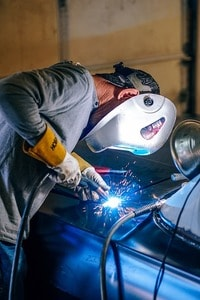 image of a welding worker with his gloves