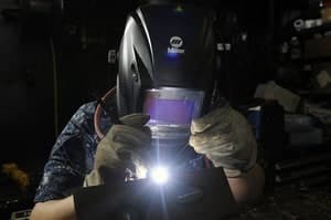 image of a welder wearing a protective gear