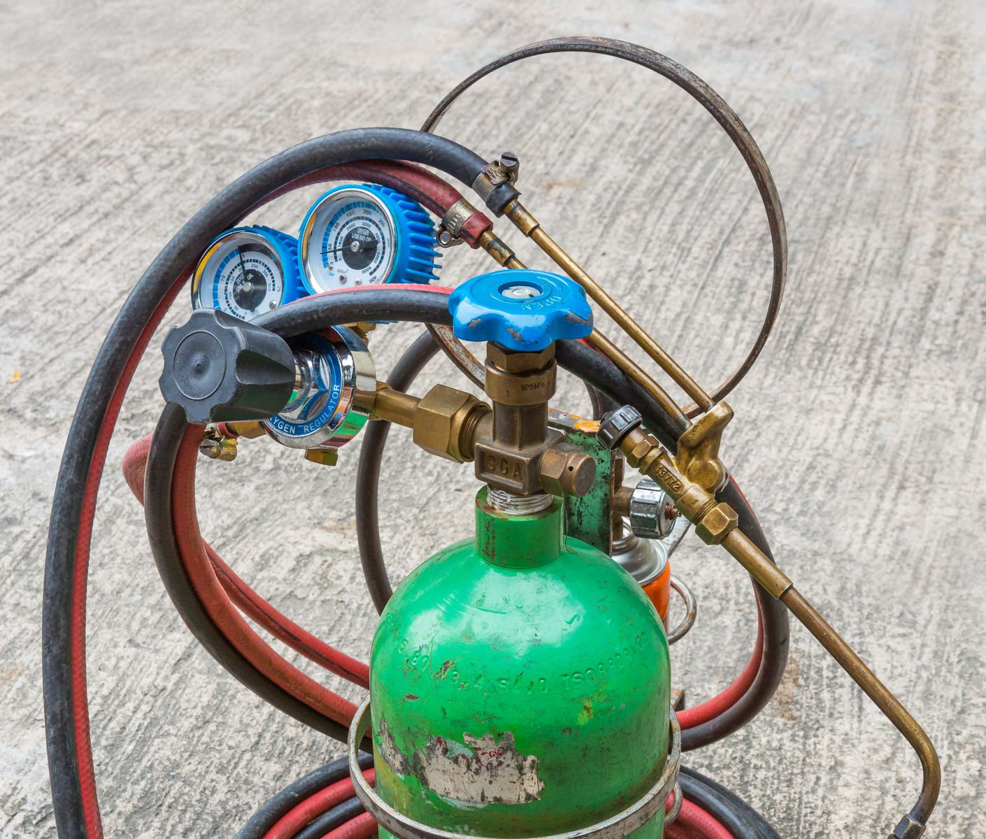 close up small gas welding kit on grunge concrete floor