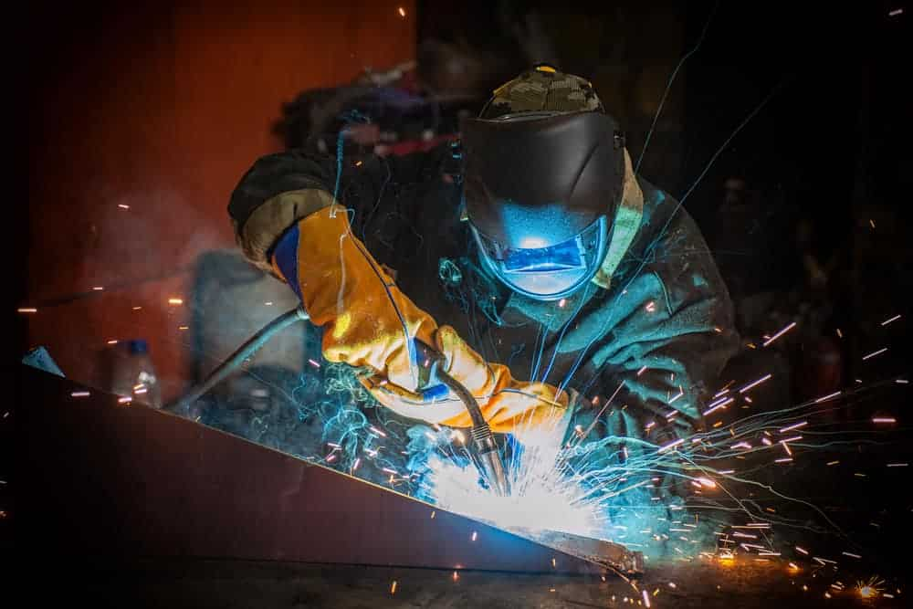 image of a worker welding metal