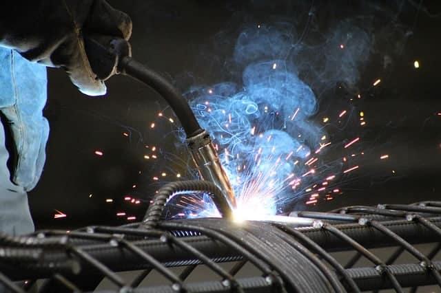 image of a welder welding steel bars