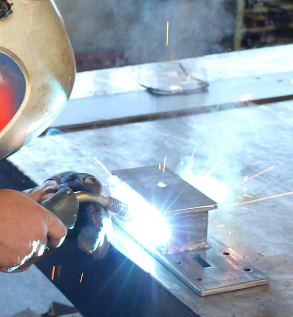 image of a welder placing a bead