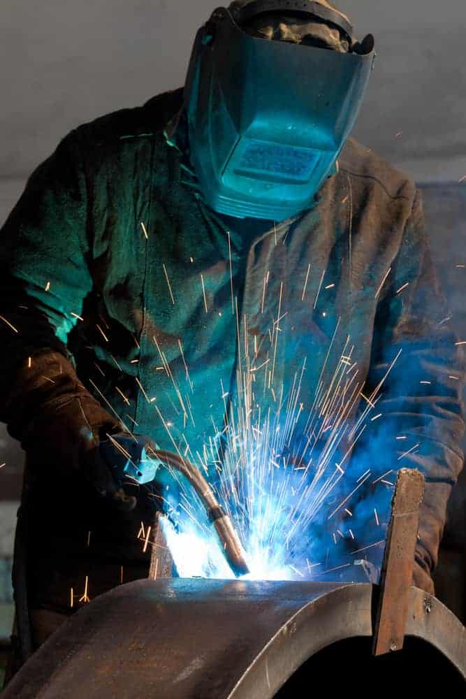 image of a worker using a MIG torch