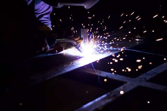 image of a welder doing a MIG weld on a sheet metal