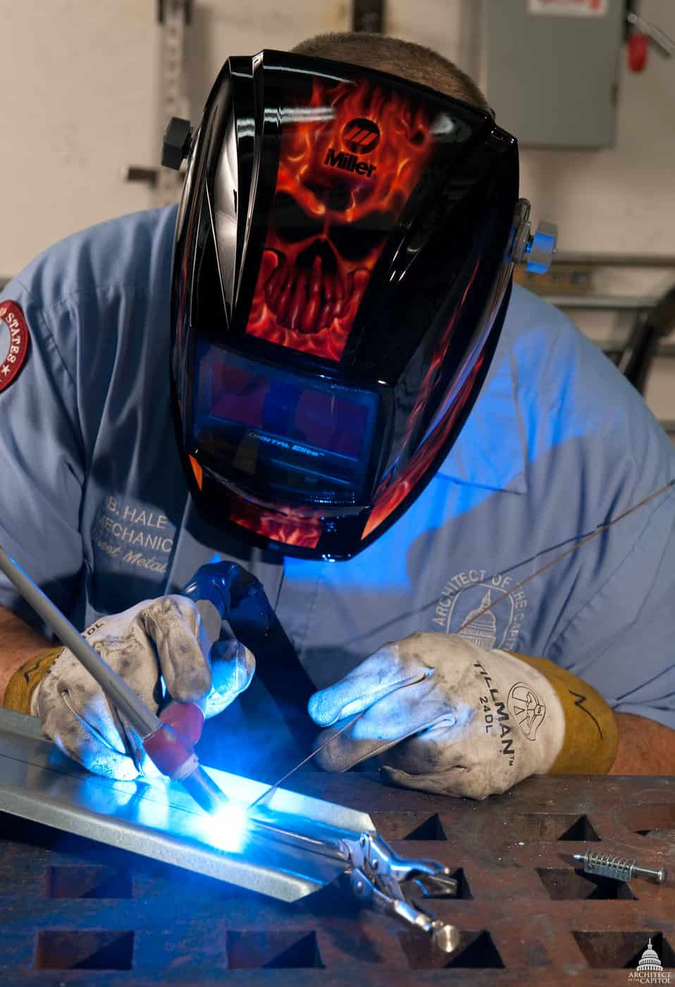 image of a welder doing a TIG weld on a sheet metal