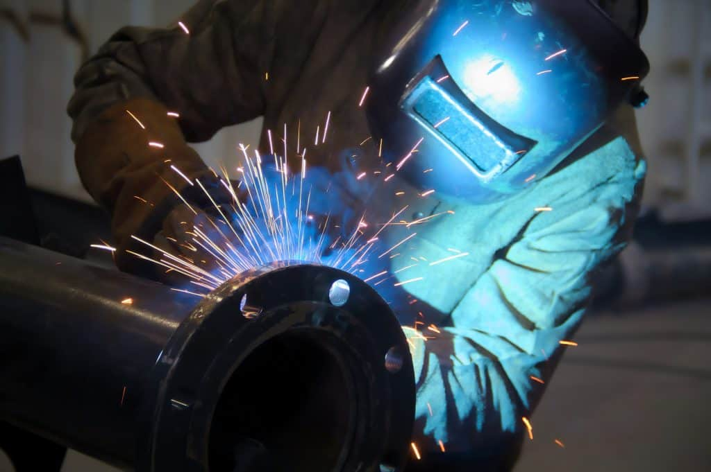image of a worker doing a pipe weld