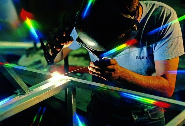 image of a welder doing a TIG weld