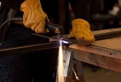 image of a worker cutting using plasma