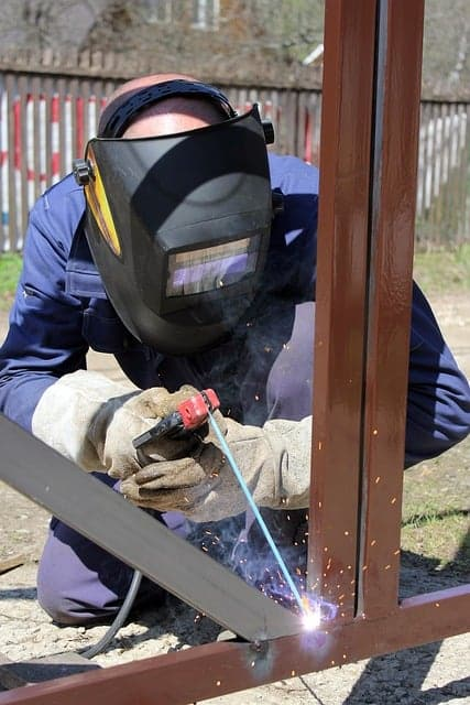 image of a welder with safety equipment on site