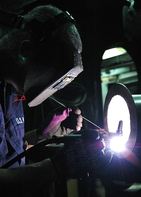 image of a worker welding