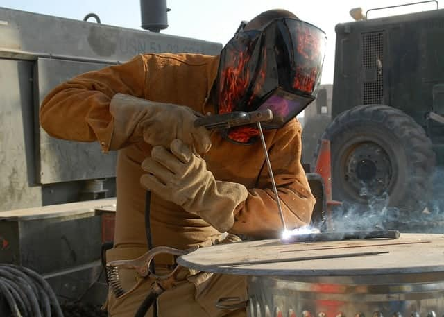image of a construction worker welding