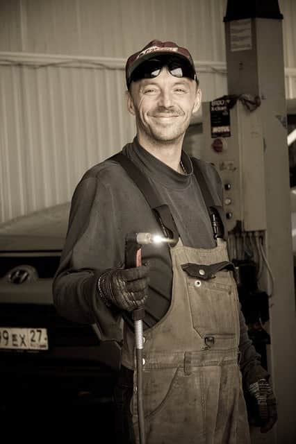 image of a mechanic with a plasma torch