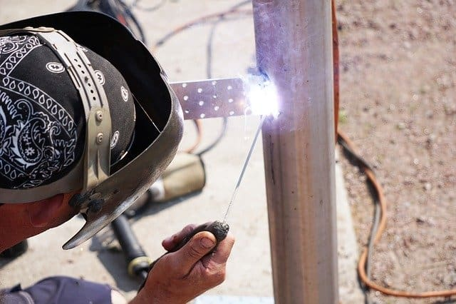 image of the worker making a stick weld