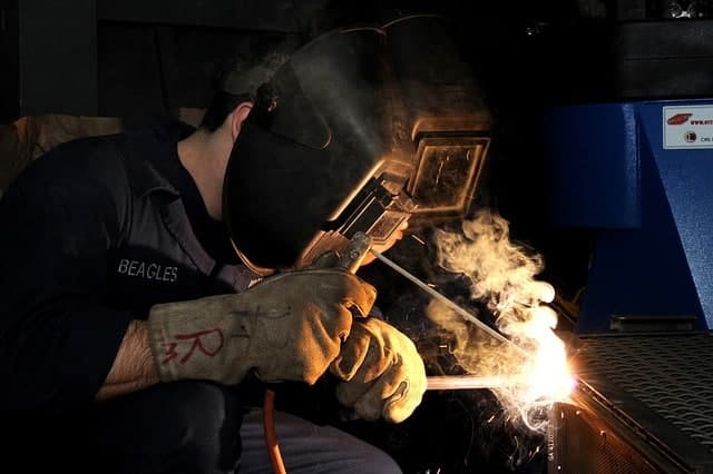 image of a worker making a stick weld