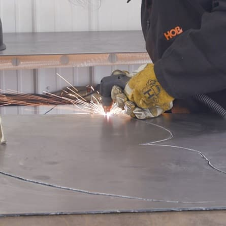 image of hobart 40i airforce plasma cutter in action