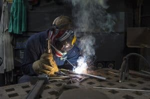 image of a welder making a stick weld