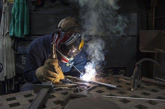 Image of a welder working with a stick welder