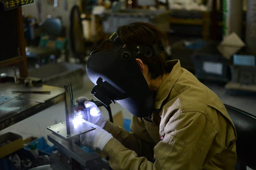 Image of a welder working with a TIG welder