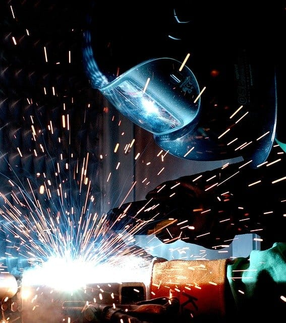 image of a worker laying a MIG weld