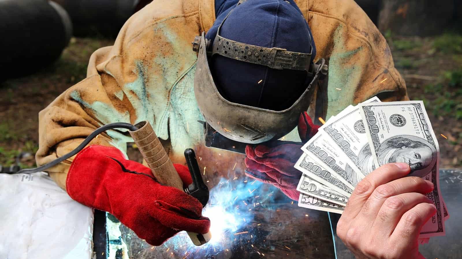 image of a welder holding money