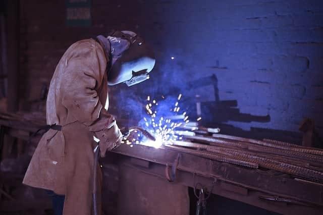 image of a welder working on mild construction steel