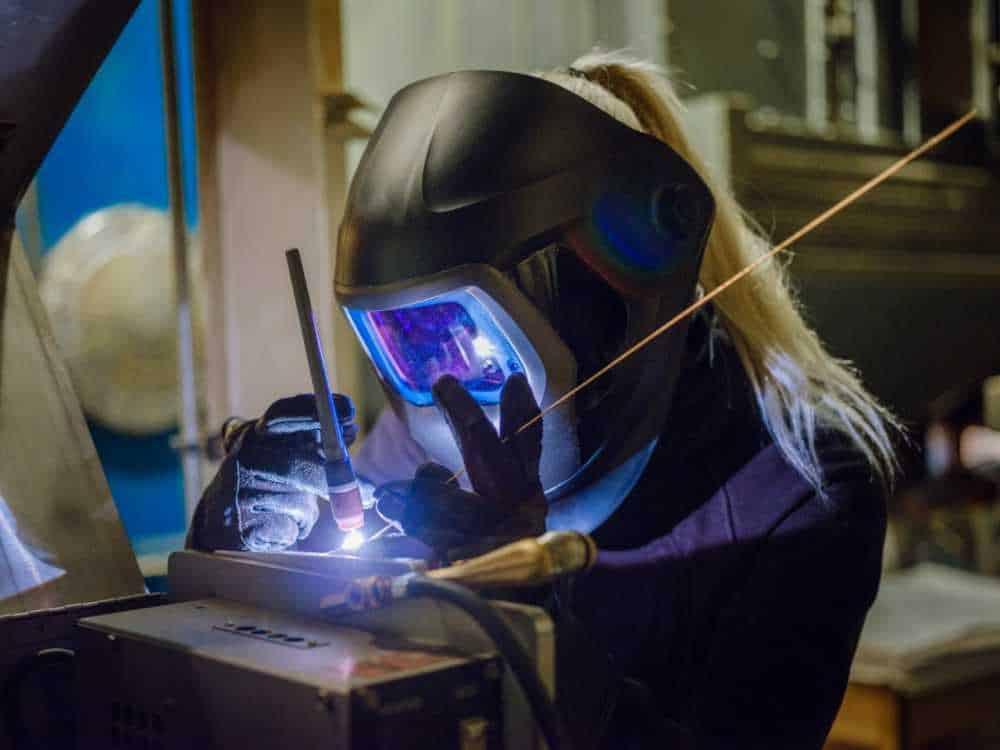 Woman using multi process welder