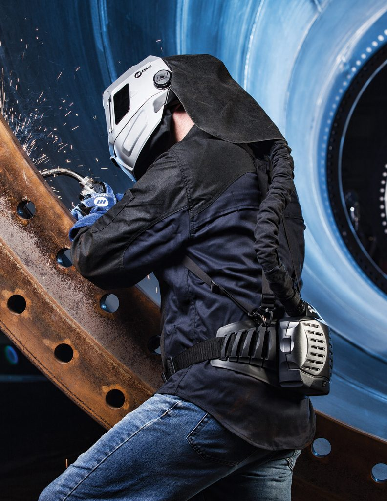 Welder welding with MIG, and using Miller PAPR welding helmet