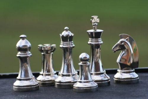 image of chess pieces made of white metals