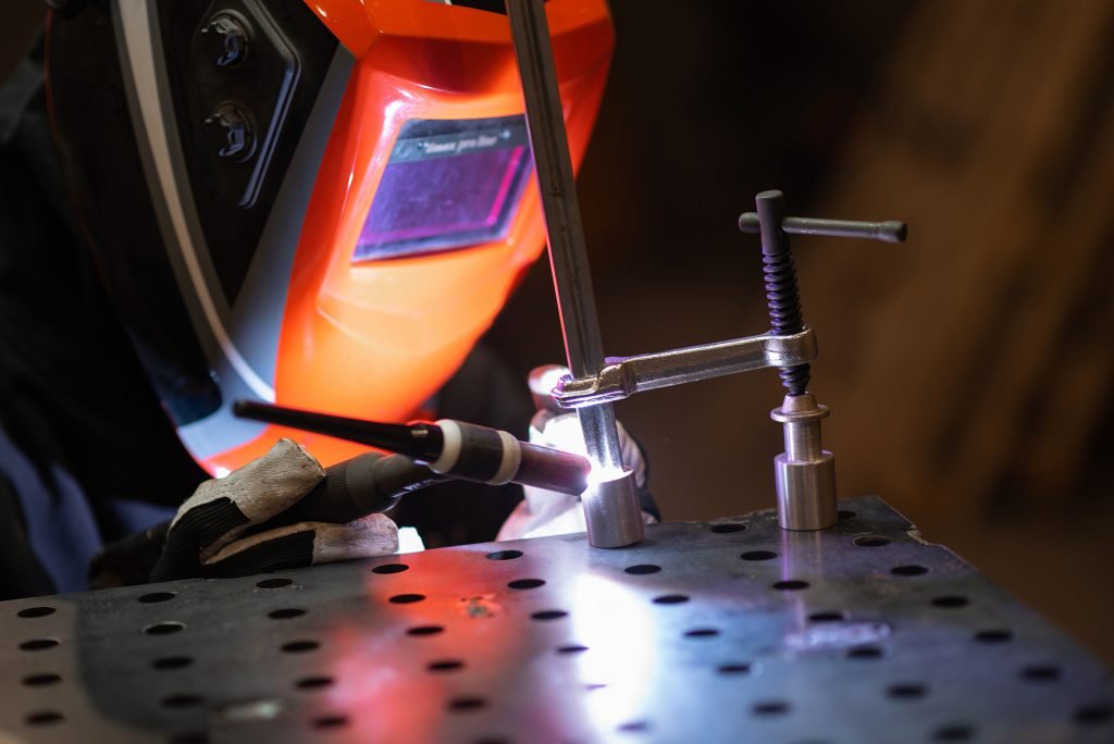 image of welder working at best welding table