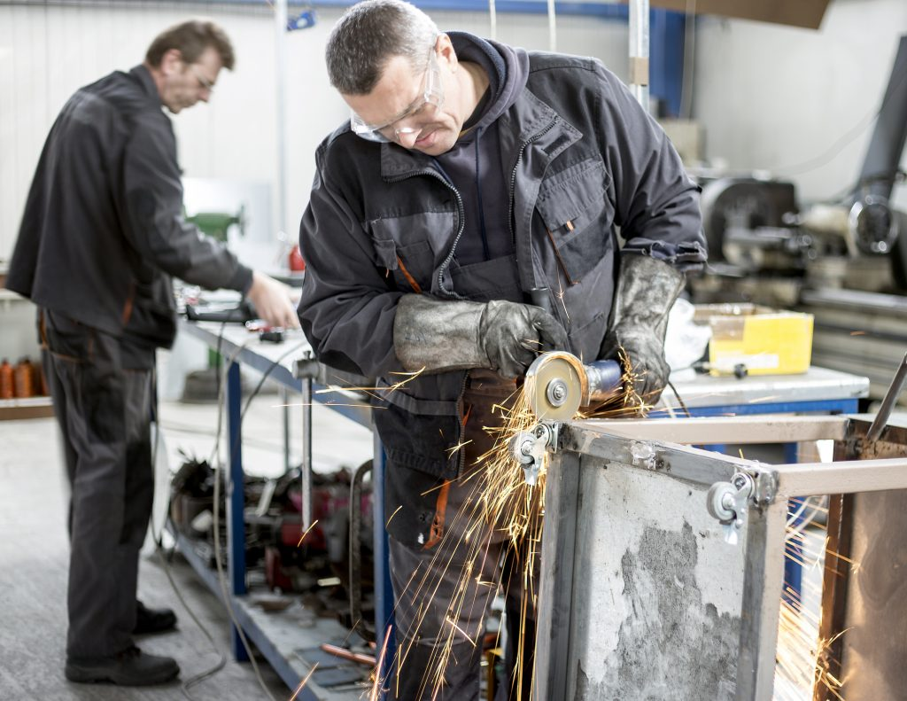 image of two workers in metal fabrication shop