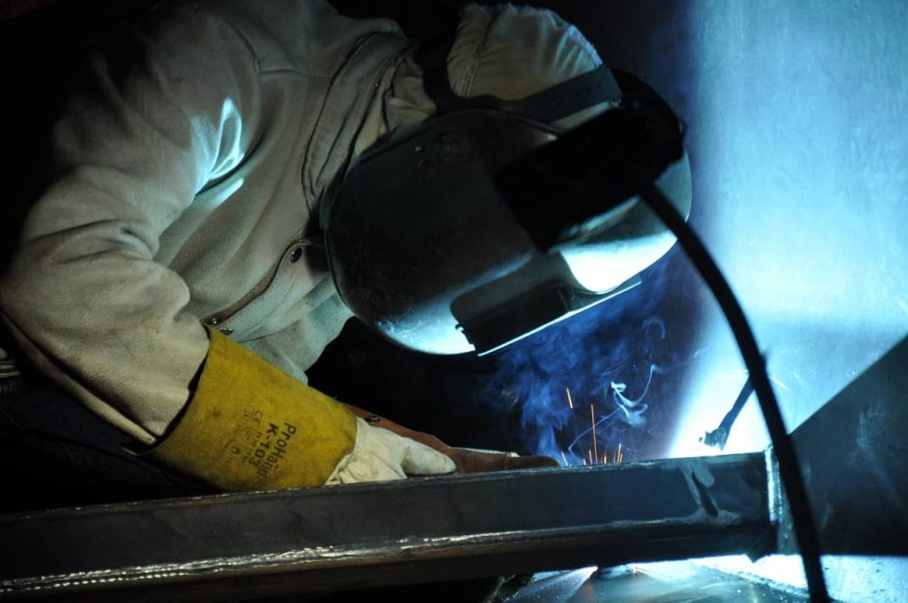image of a welder in proper safety clothing