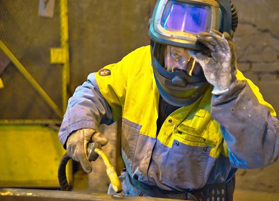 image of a man wearing a welding helmet