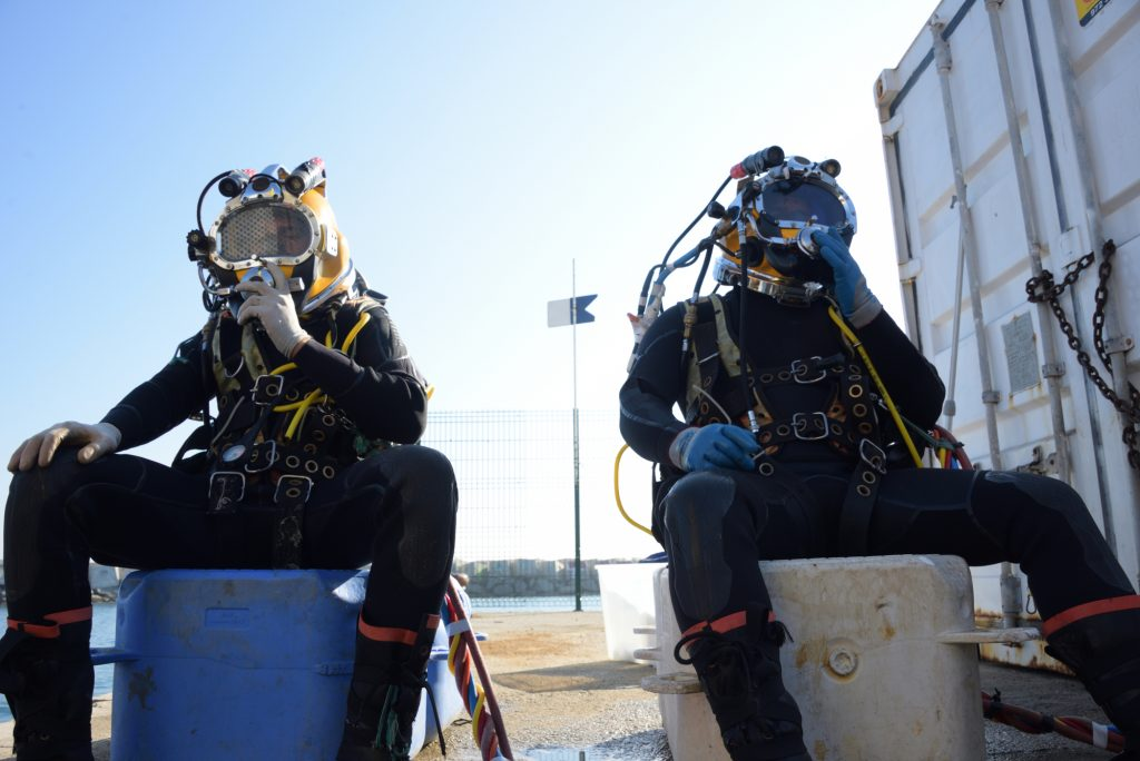 image of two commercial divers getting ready to work